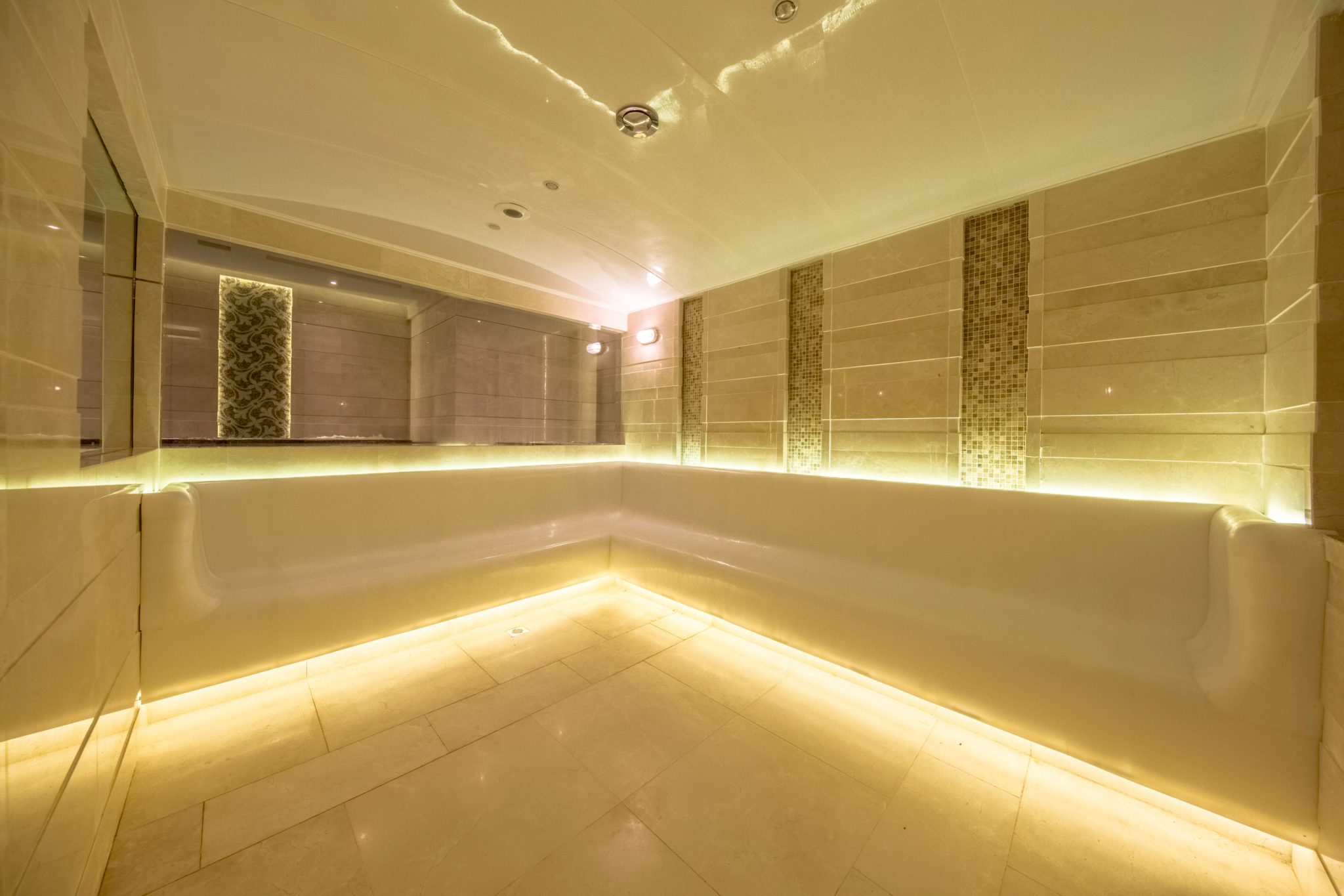 Belgravia steam room with textured stone and polished plaster